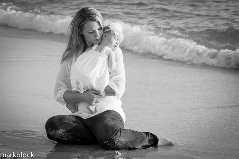 Portrait photo of a mother and infant daughter on Naples beach by Mark Block Photography